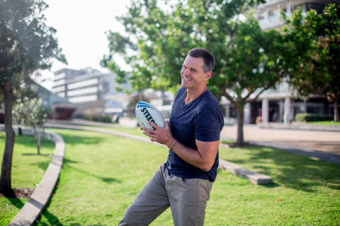 Paul Harragon catching an NRL football in 2018