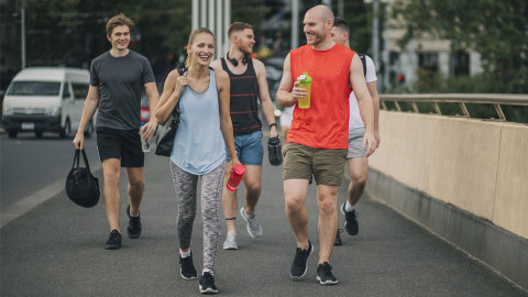 A group of friends walking together after a gym workout