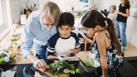 Family at home cooking with the help of a dietitian