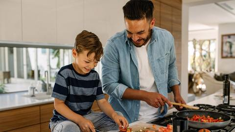 A father cooking a healthy dinner with his son