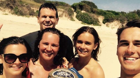 Paul Harragon and his family on a beach holiday