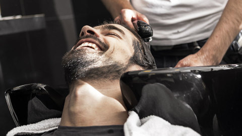 man getting hair washed at hairdressers