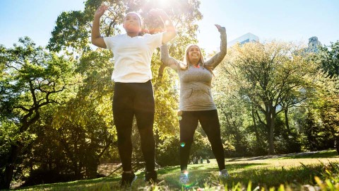 Two women exercising in a park together