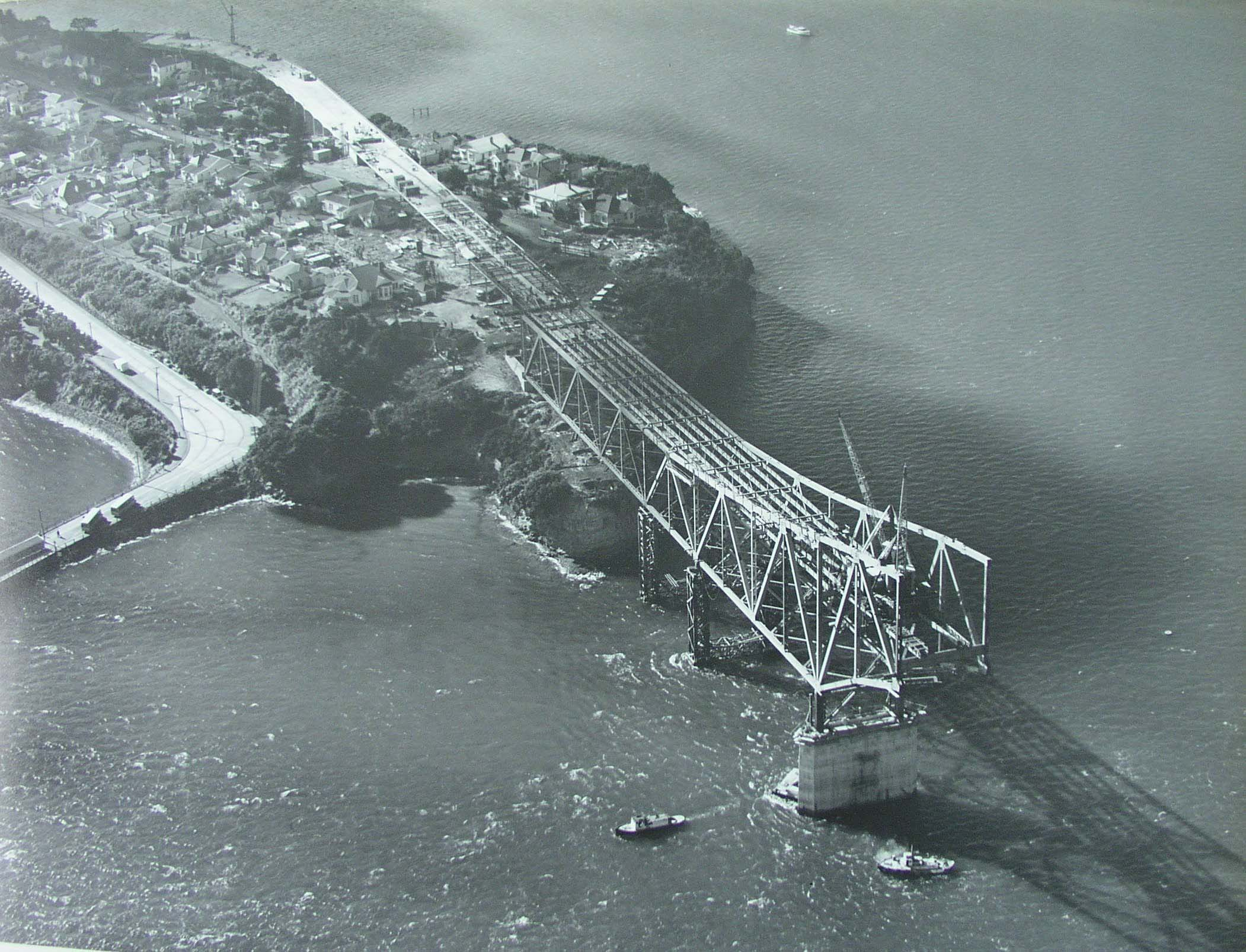 Aerial shot showing construction of Auckland Harbour Bridge on 5 August 1958