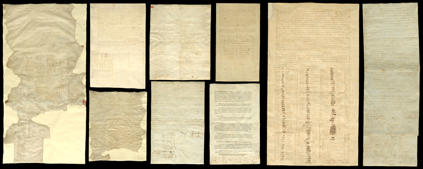Sheets of parchment and old paper with script and signatures on a black background