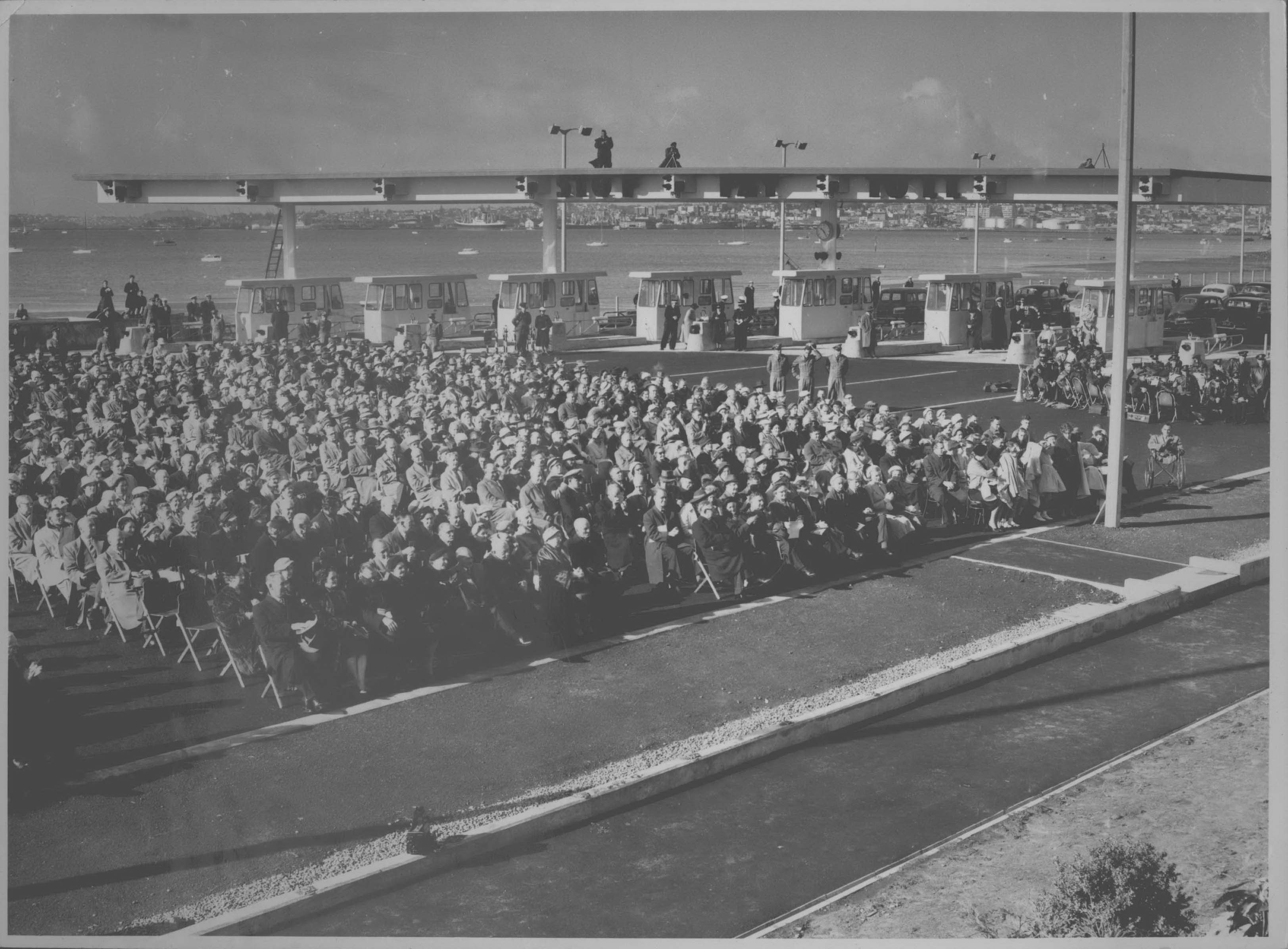 Showing the crowd who are seated at the official Bridge opening