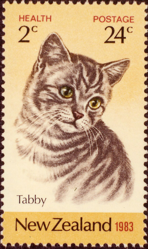 24 cent postage stamp with a cute tabby cat illustration