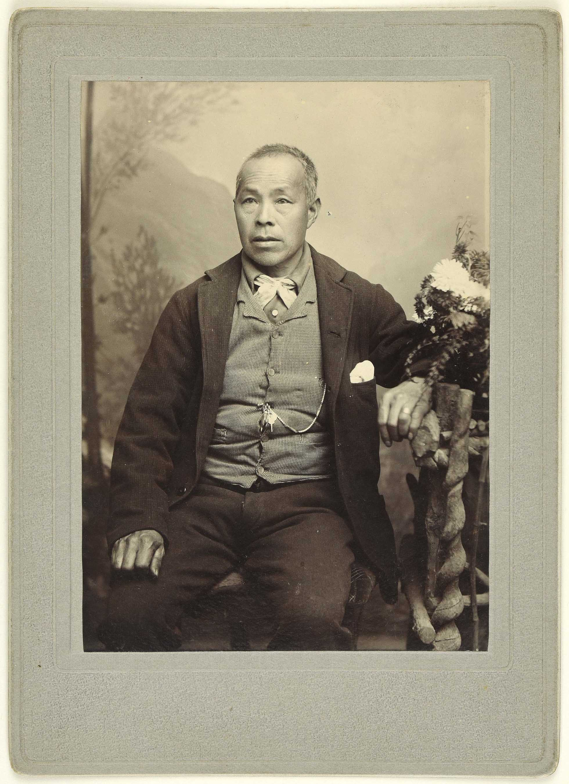 Sepia photo portrait of a Chinese man sitting