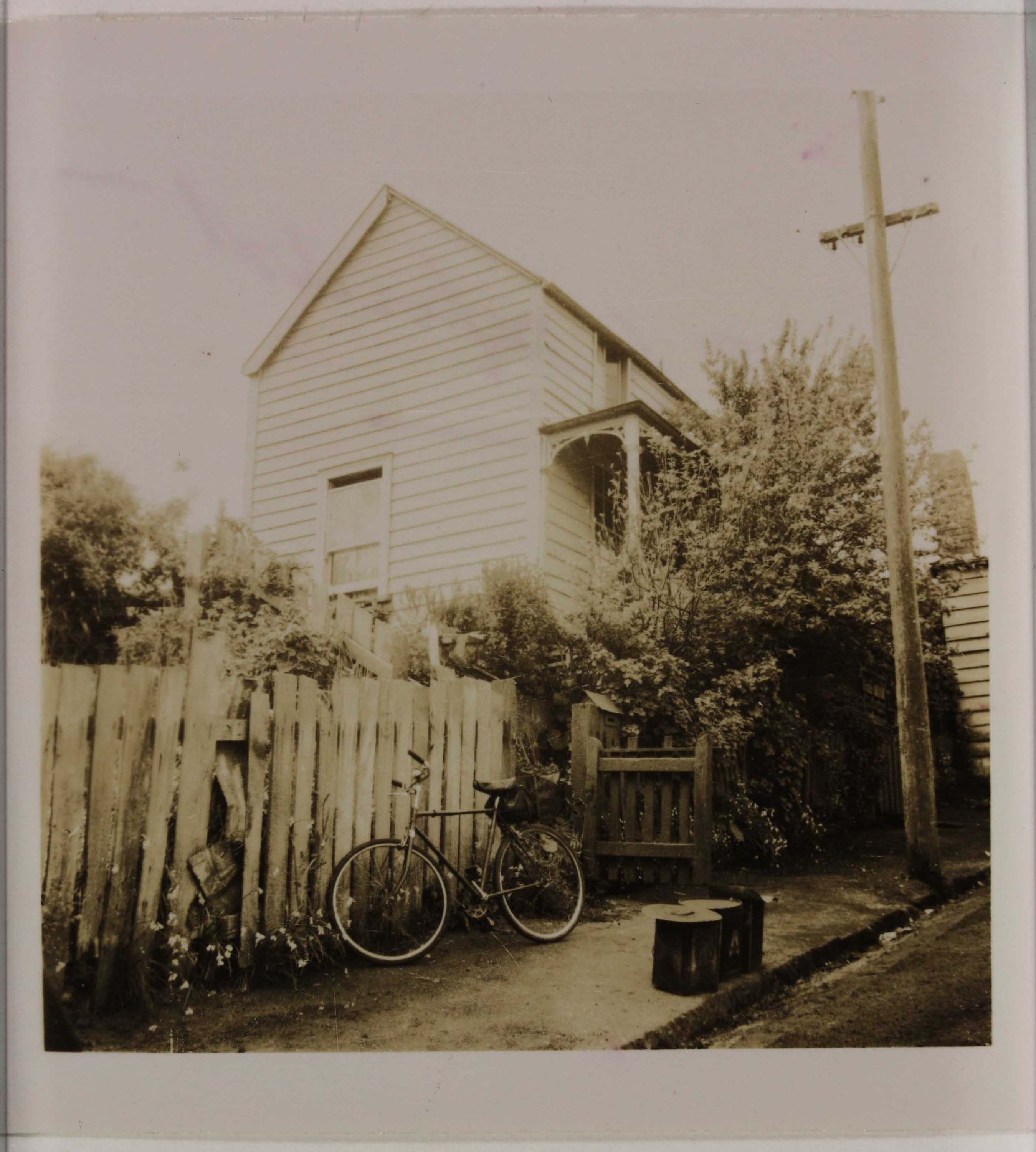 Sepia photo of a house from the street