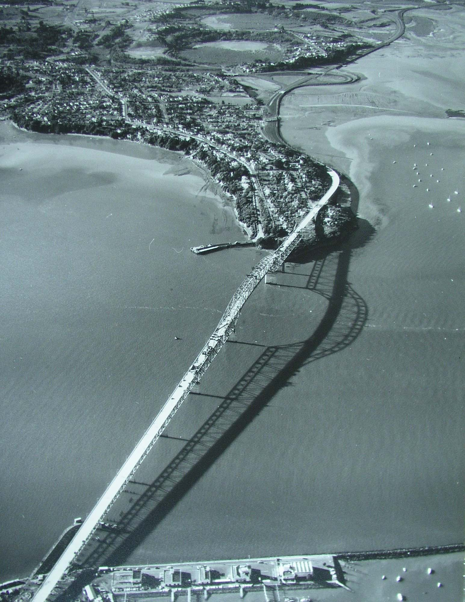 Aerial photo showing construction progress on Auckland Harbour Bridge on 13 April 1959