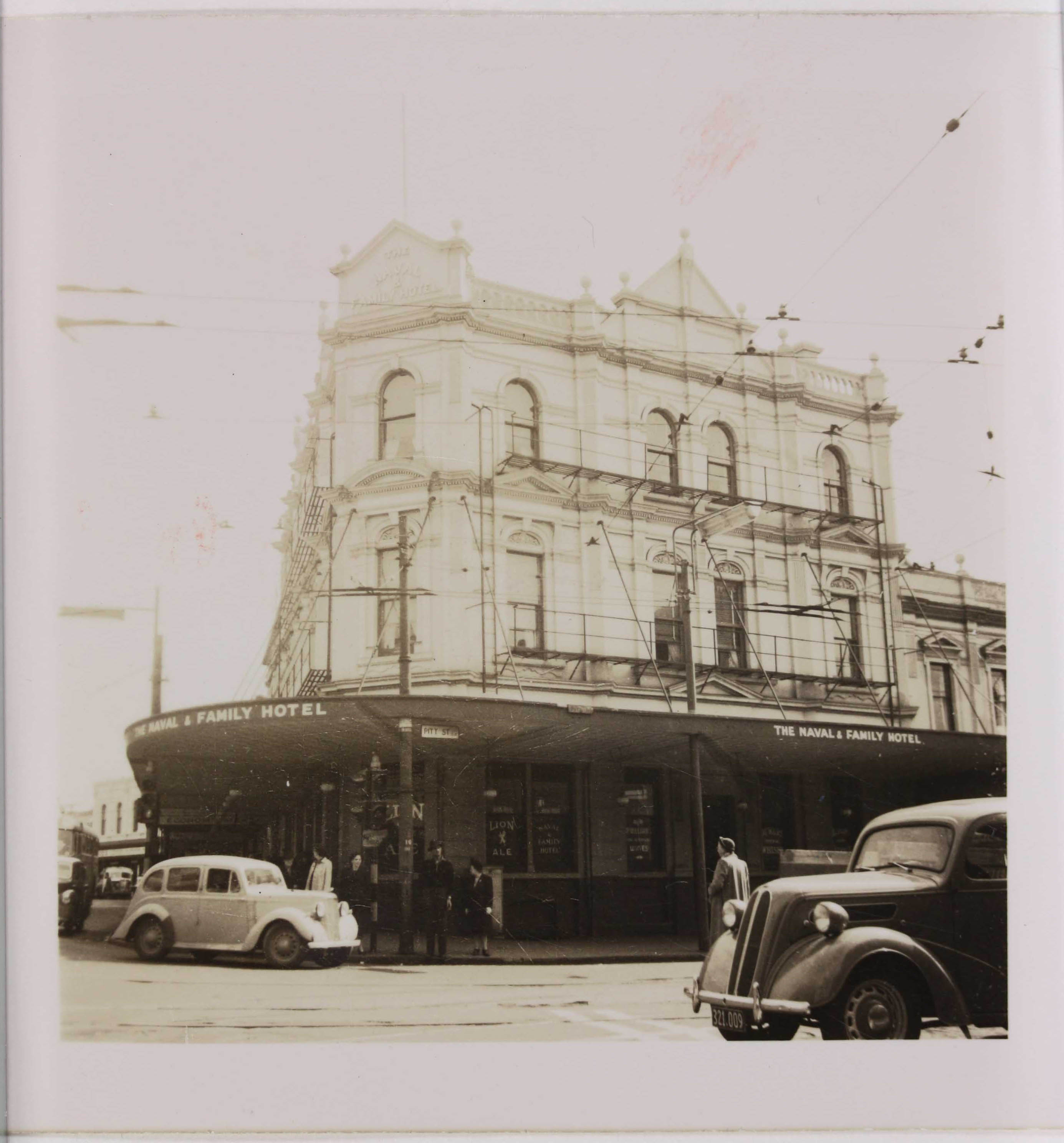 Sepia photo of a hotel from the street