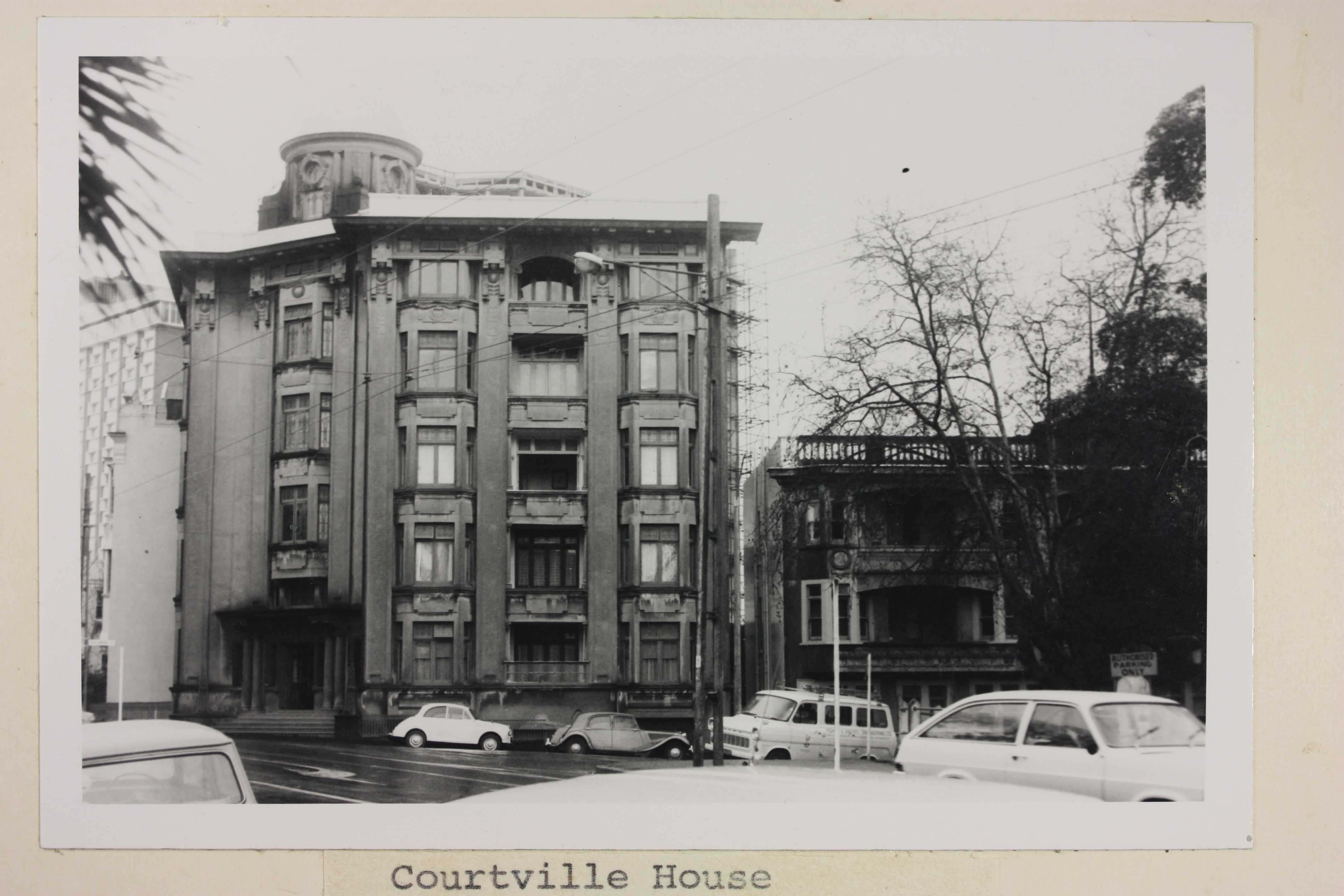 Black and white image of a large building from the street