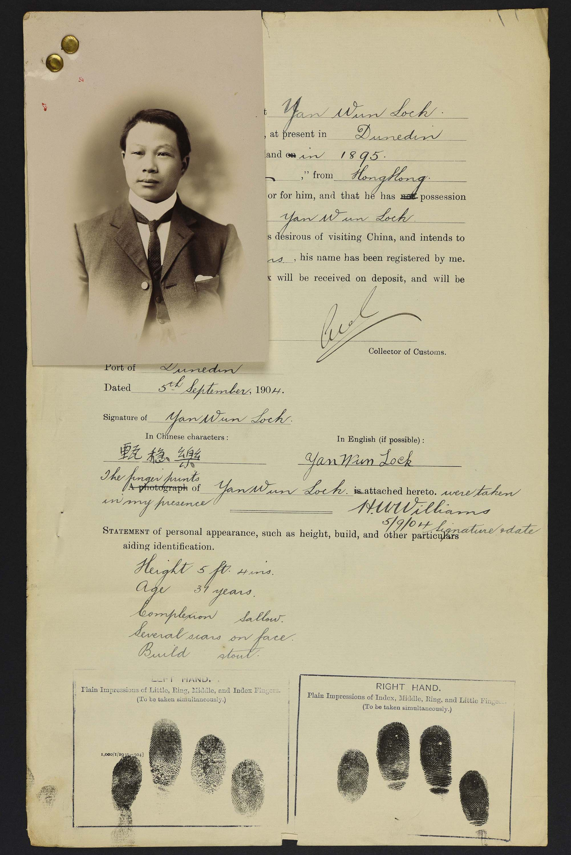 Sepia photo portrait of a Chinese man pinned to his immigration papers