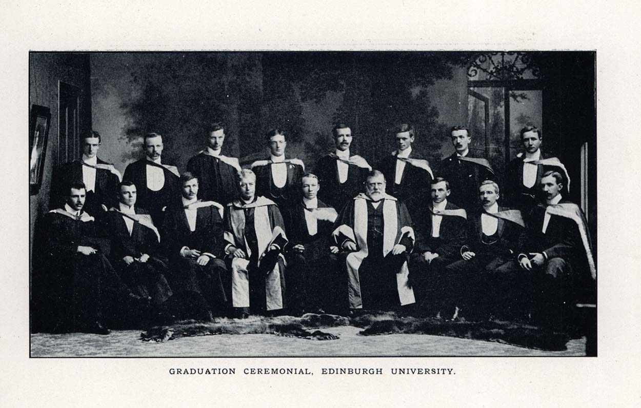Photo of men posing for a photo in graduation wear