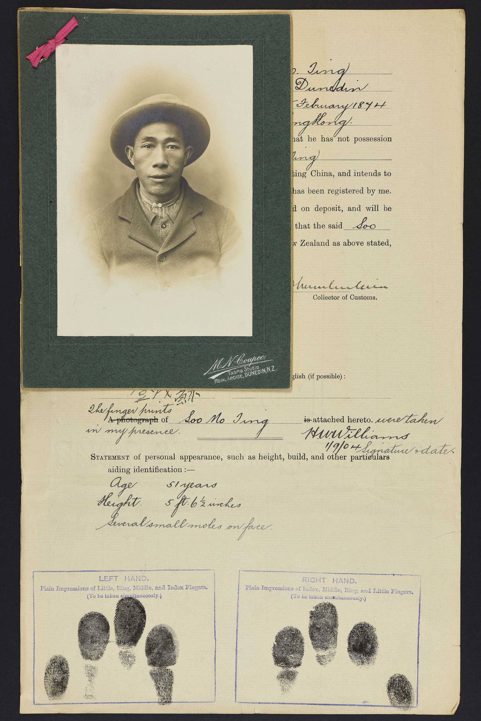 Sepia photo portrait of a Chinese man in a wide brimmed hat pinned to his immigration papers