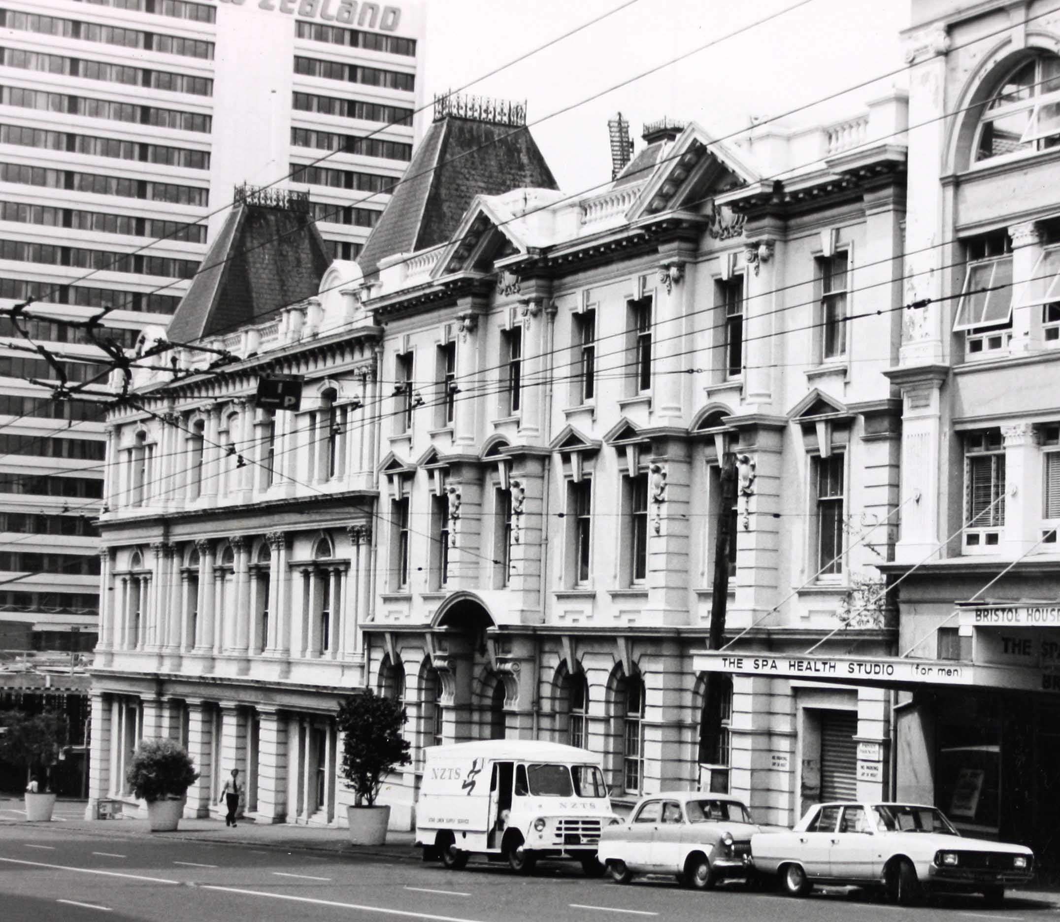 Black and white photo of a building from the street