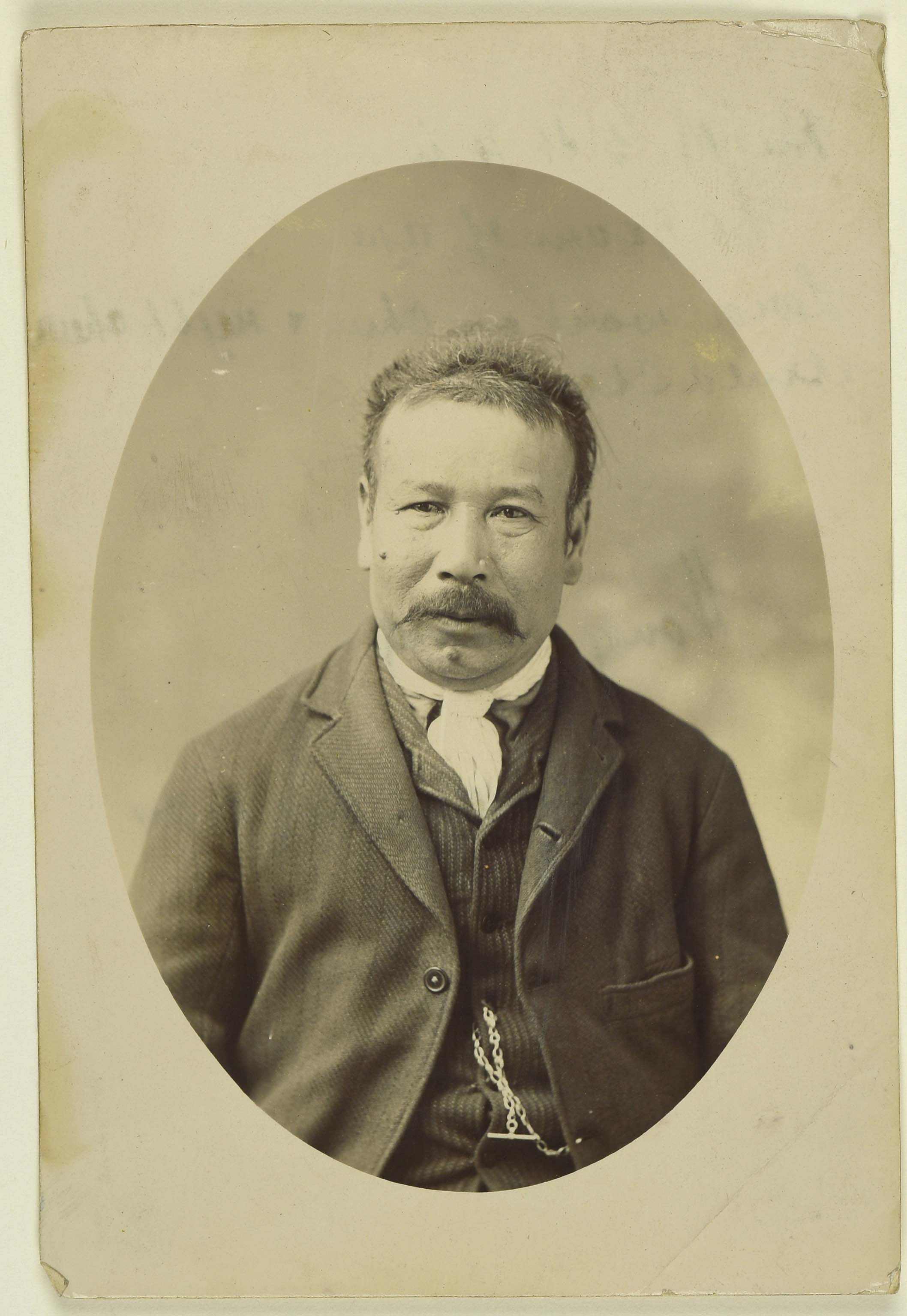 Sepia photo portrait of a Chinese man with a moustache