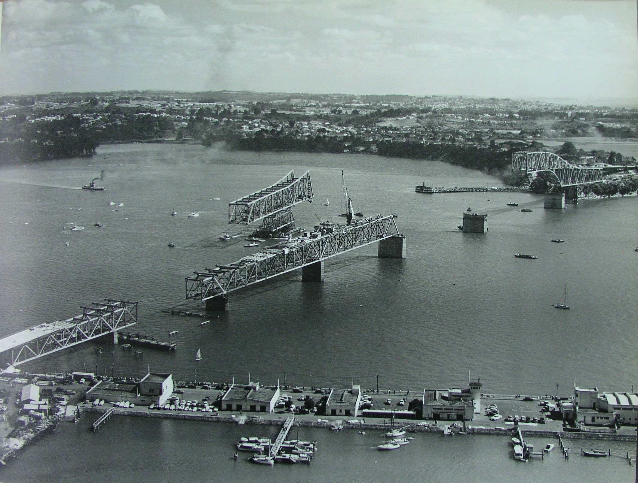 Aerial photo showing construction of Auckland Harbour Bridge on 29 November 1958