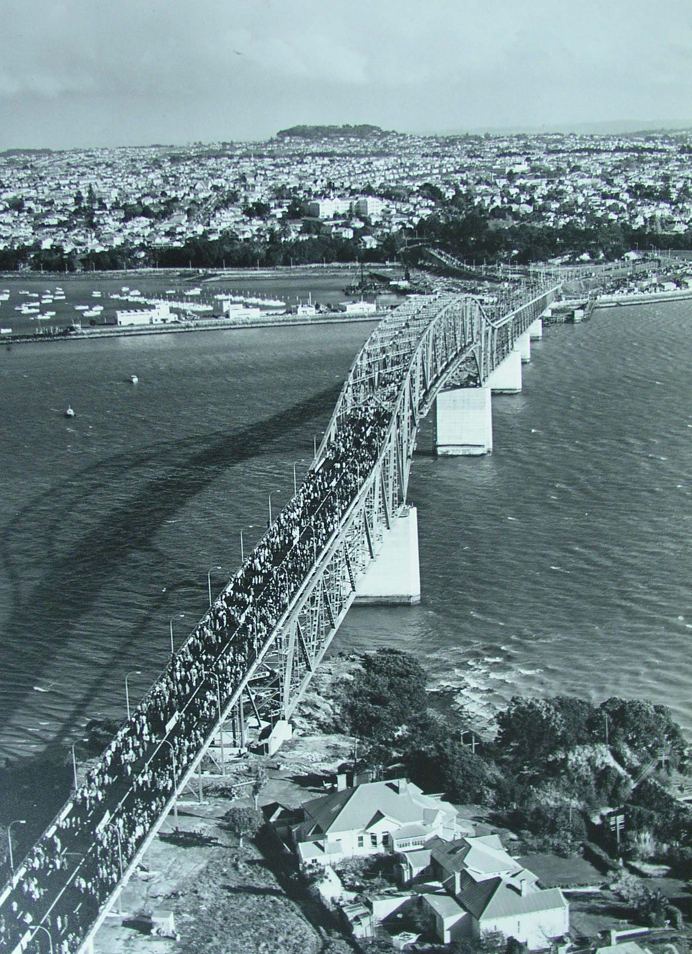 A large number of people crossing the completed Auckland Harbour Bridge