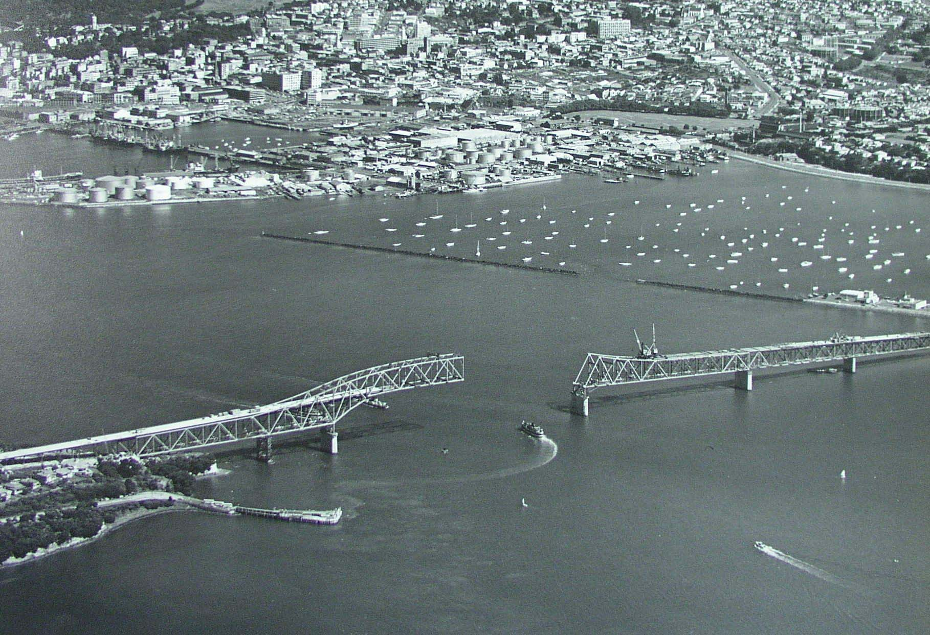 Aerial photo showing the construction of Auckland Harbour Bridge on 16 January 1959