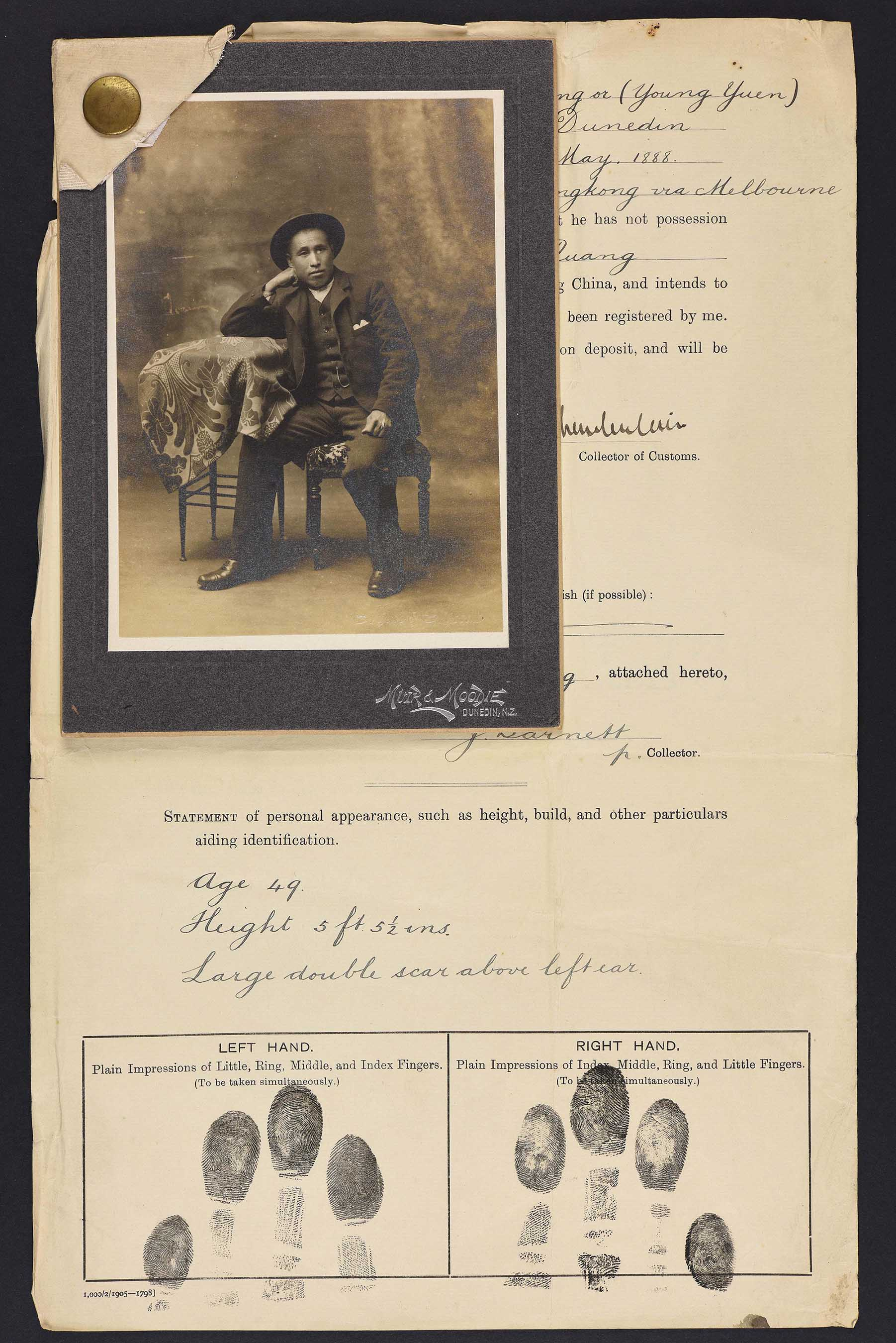 Sepia photo of a seated Chinese man resting on his right hand. Attached to his immigration papers.