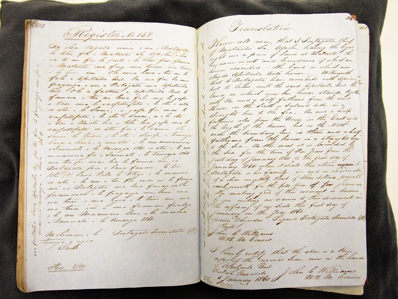 Photograph of a large book of handwritten script