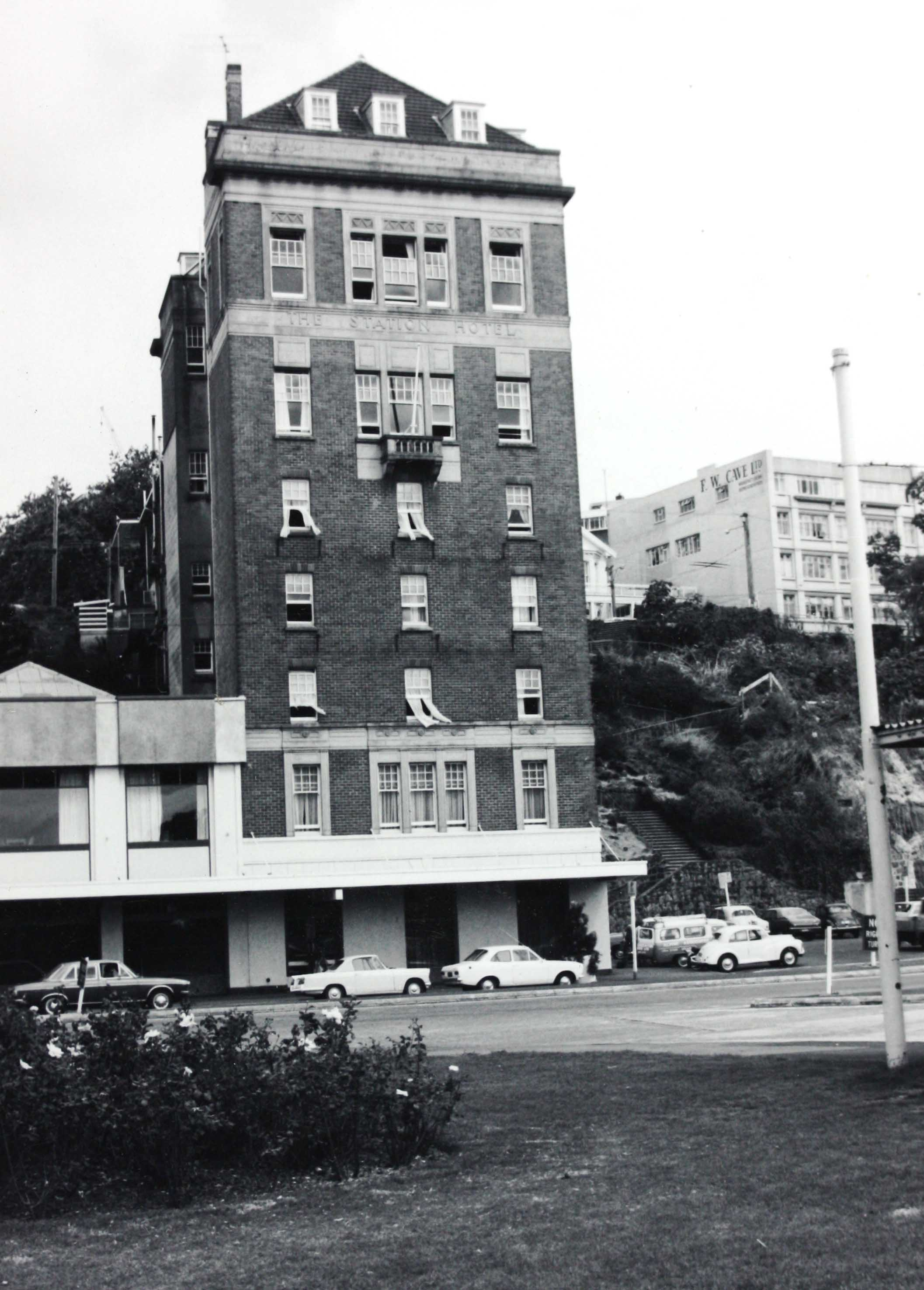 Black and white photo showing the front of a tall building