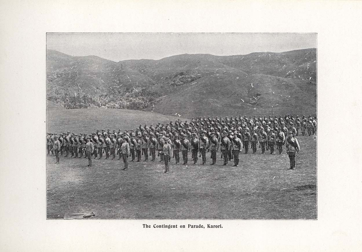 Black and white photo showing military standing in a field in formation