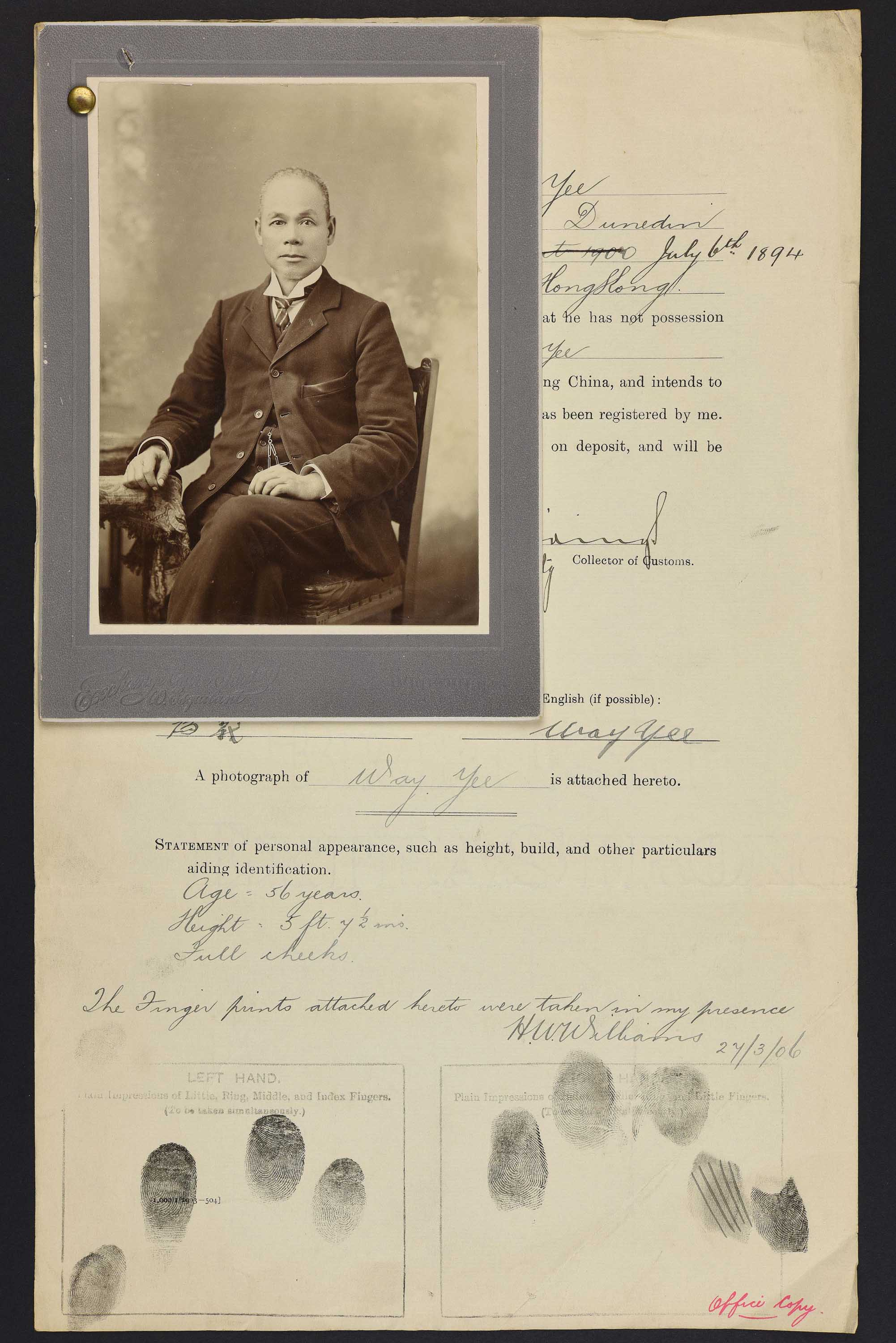 Sepia photo of a seated Chinese man attached to his immigration papers.