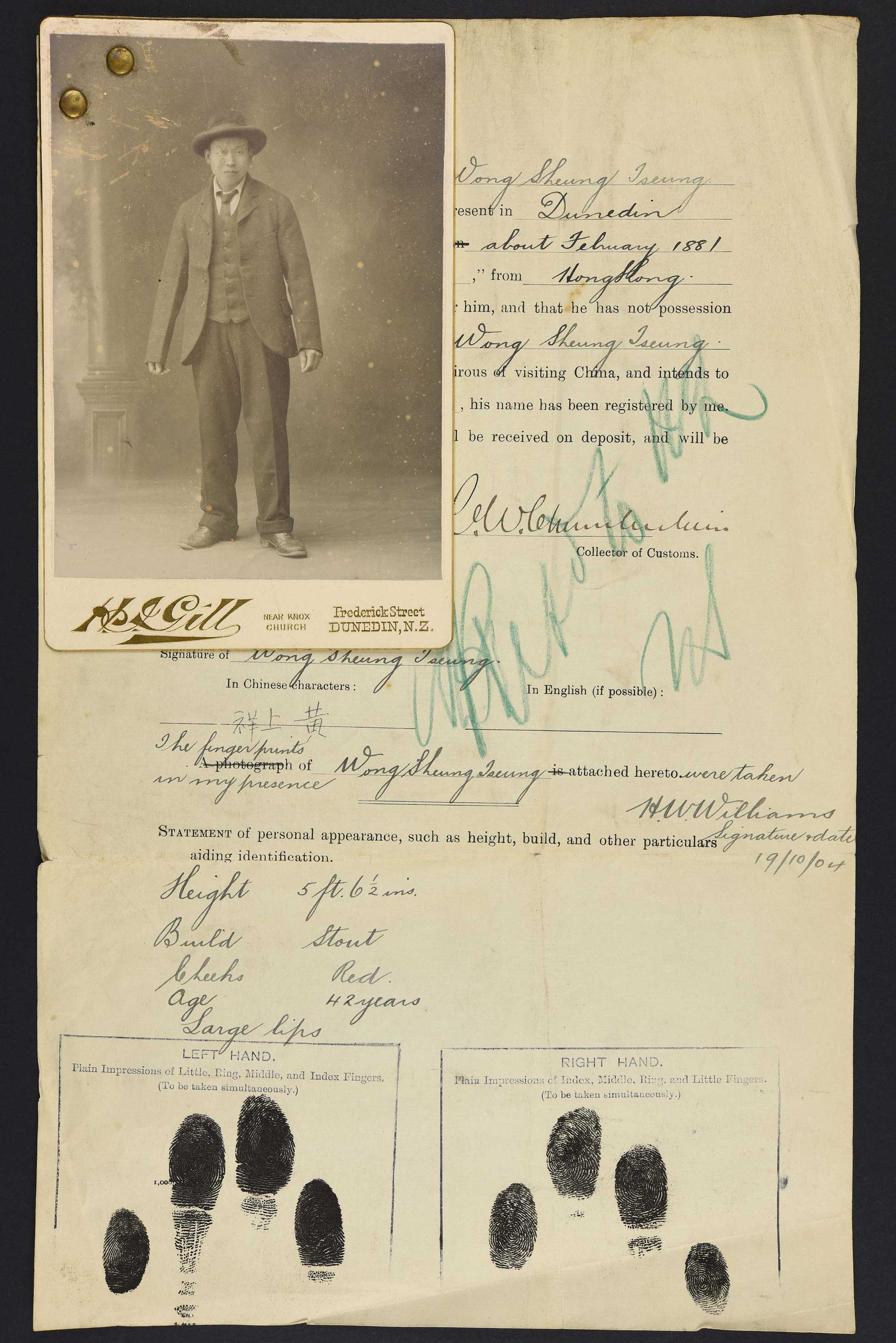 Sepia photo portrait of a standing Chinese man pinned to his immigration papers