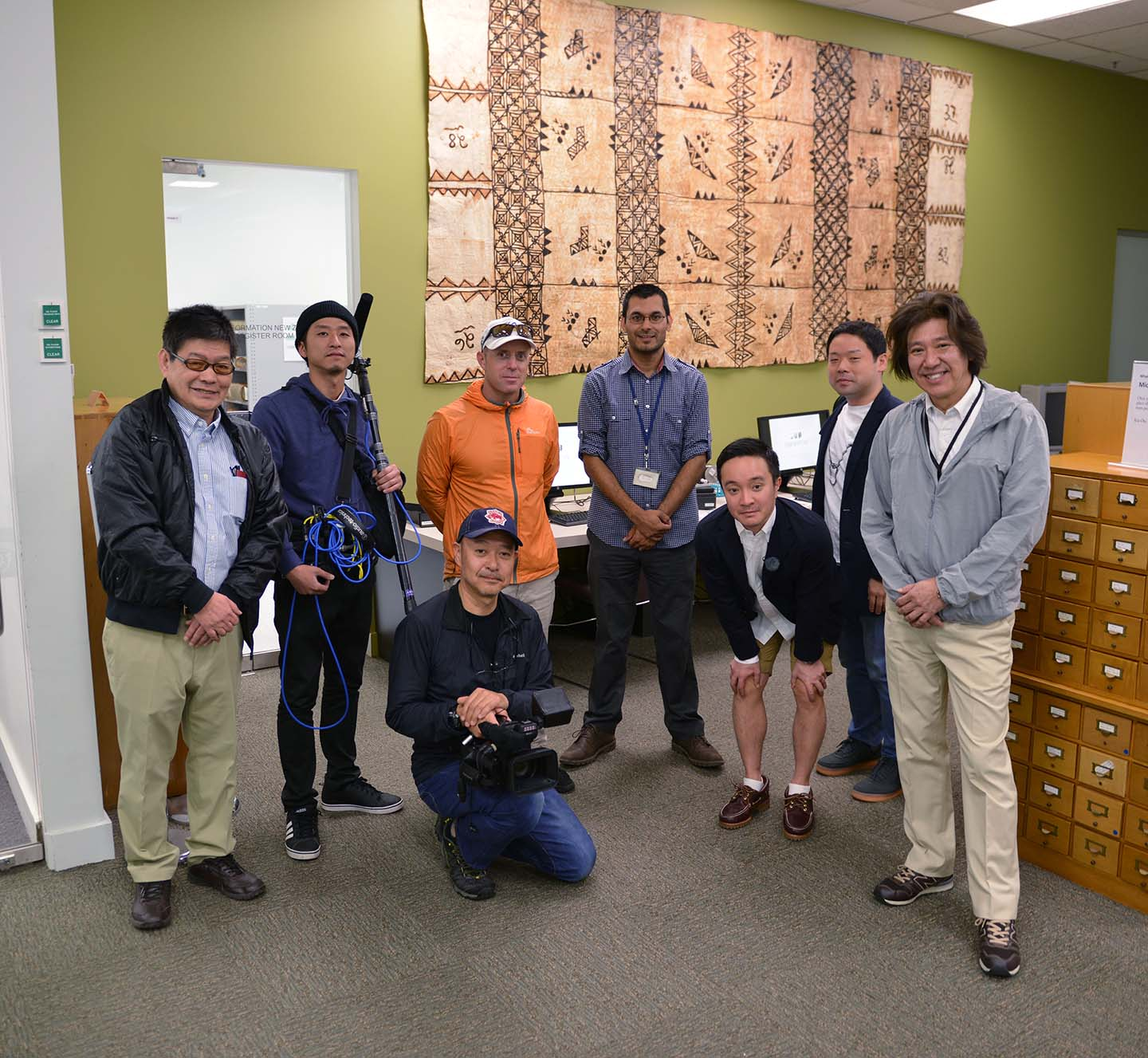 A photo showing Japanese TV film crew with an archivist