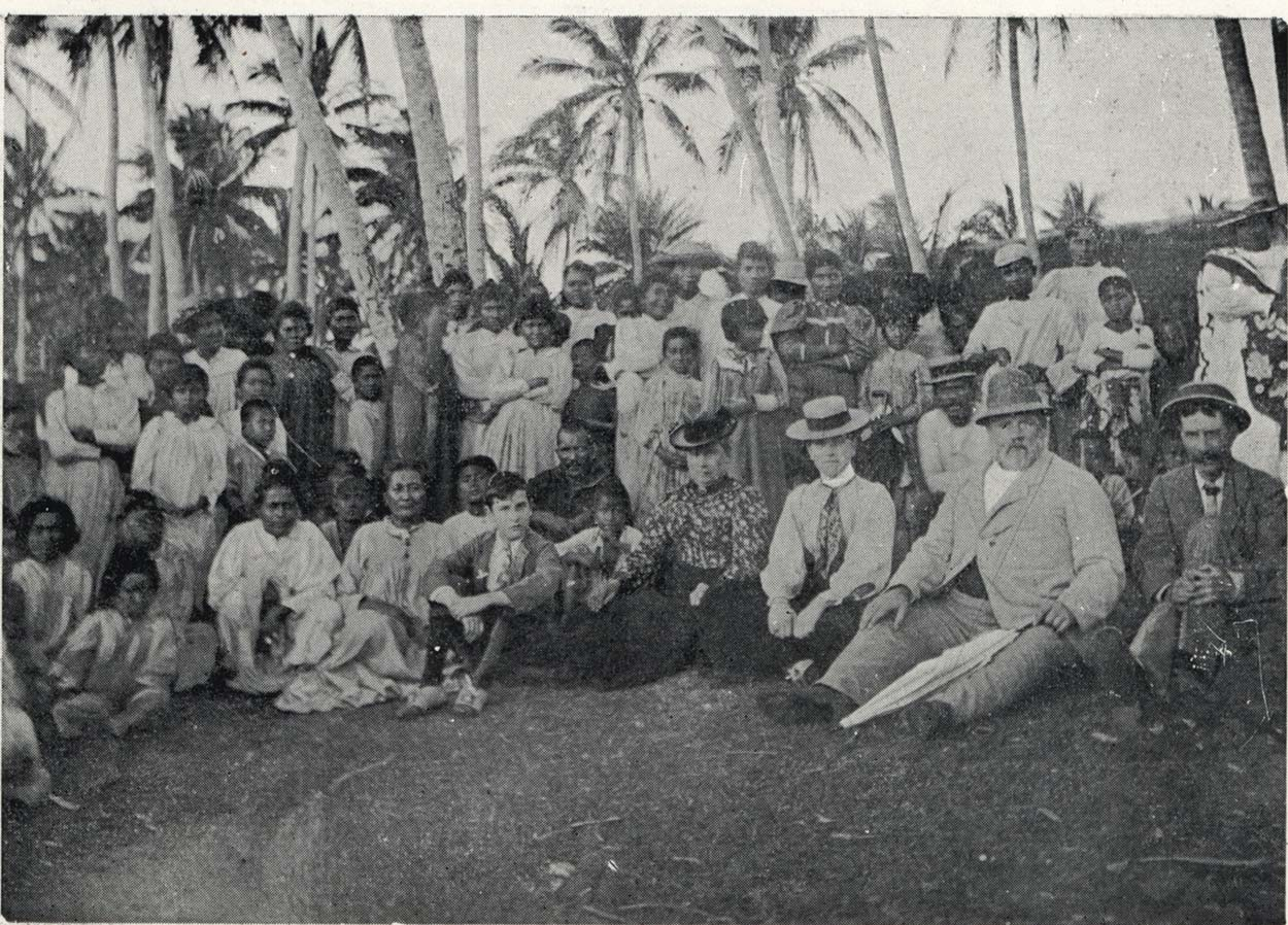 Richard Seddon and others sitting under palm trees