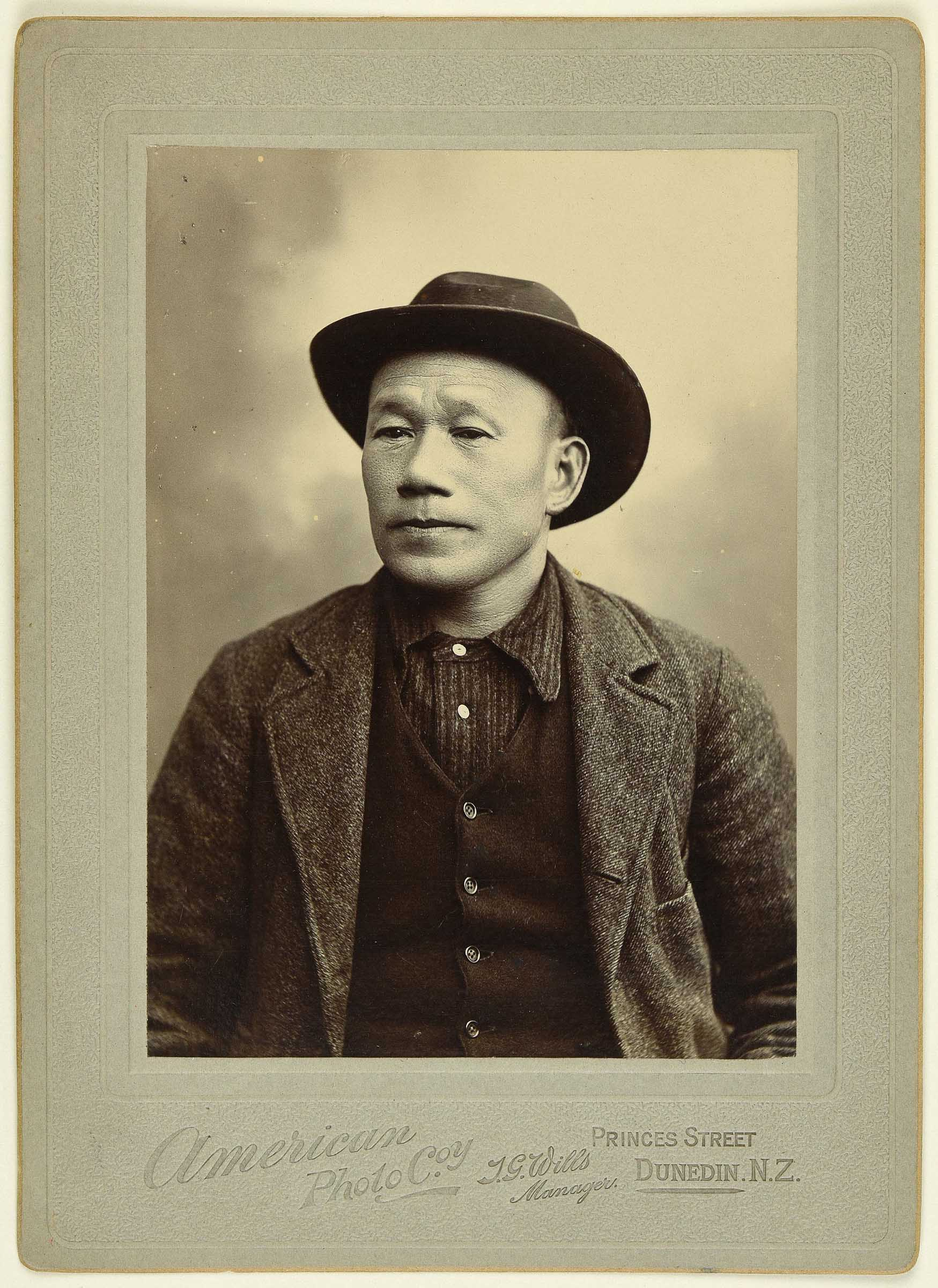 Sepia photo portrait of a Chinese man with wide brimmed hat