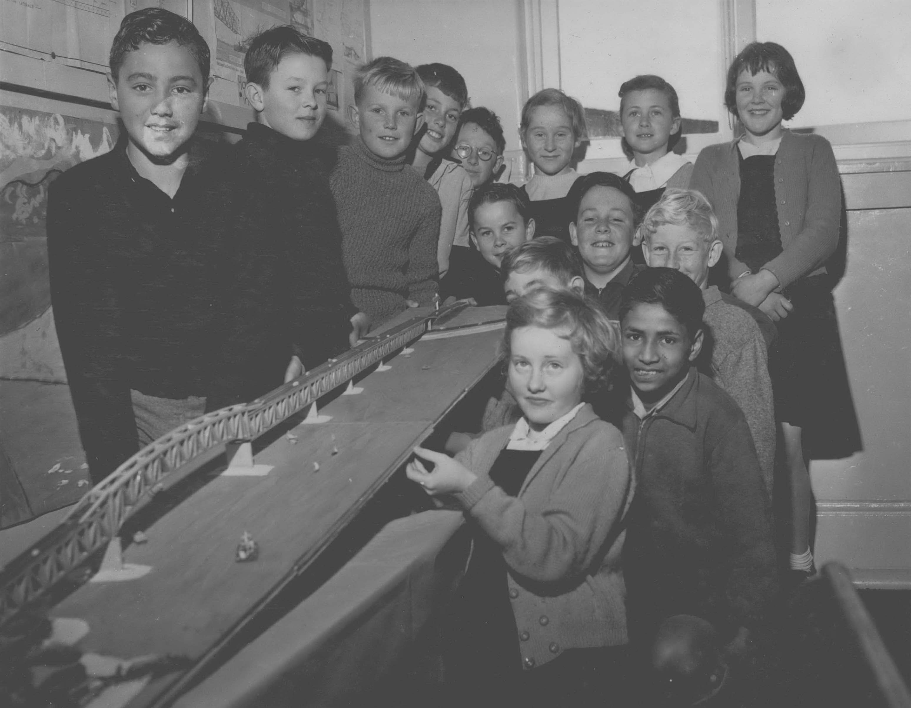 Pupils of the school pose with model of the bridge