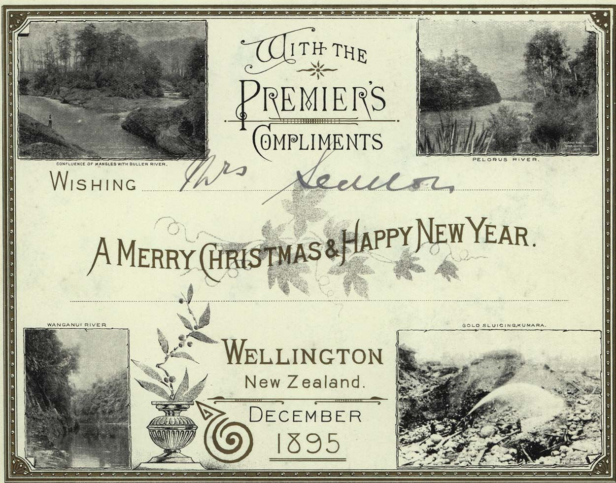 "A card ""With the Premier's Compliments"" showing photographs of rural Wellington"