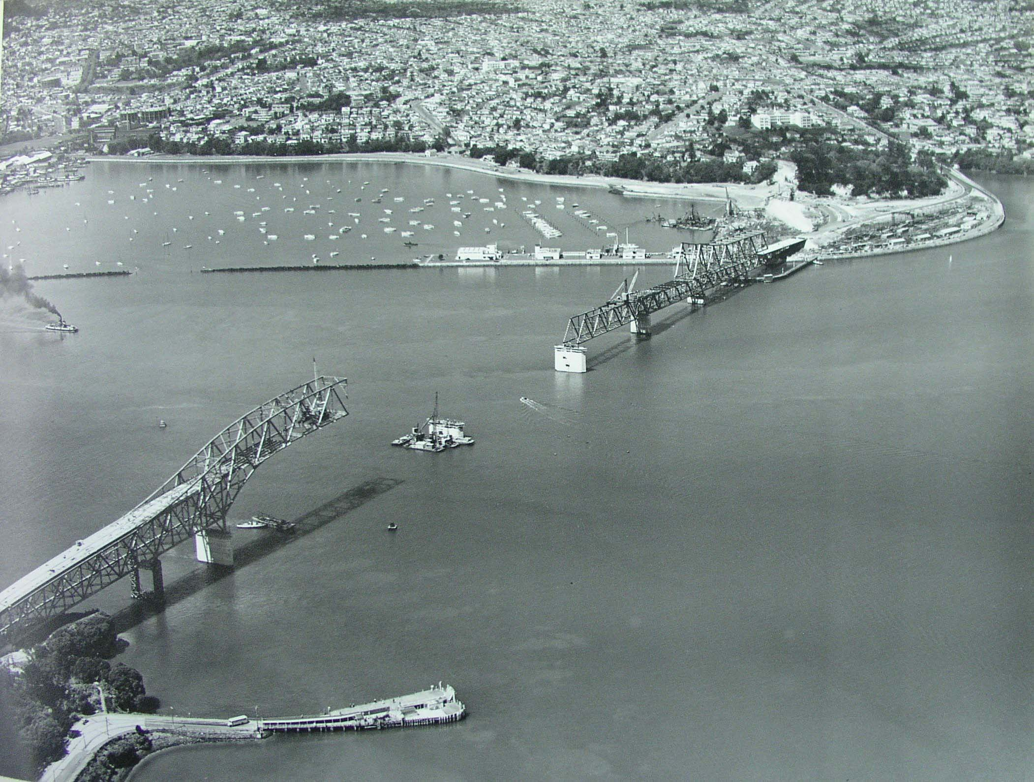 Aerial photo showing construction of Auckland Harbour Bridge on 29 October 1958