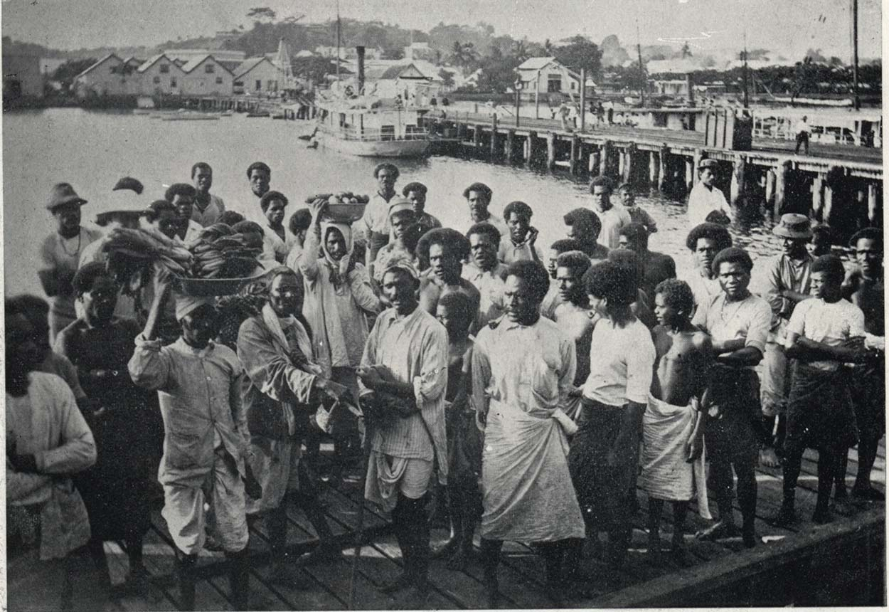 Locals standing on a wharf in Suva