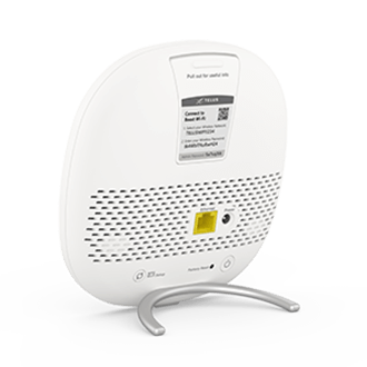Back view of a white TELUS Boost Wi-Fi device with an Ethernet port.