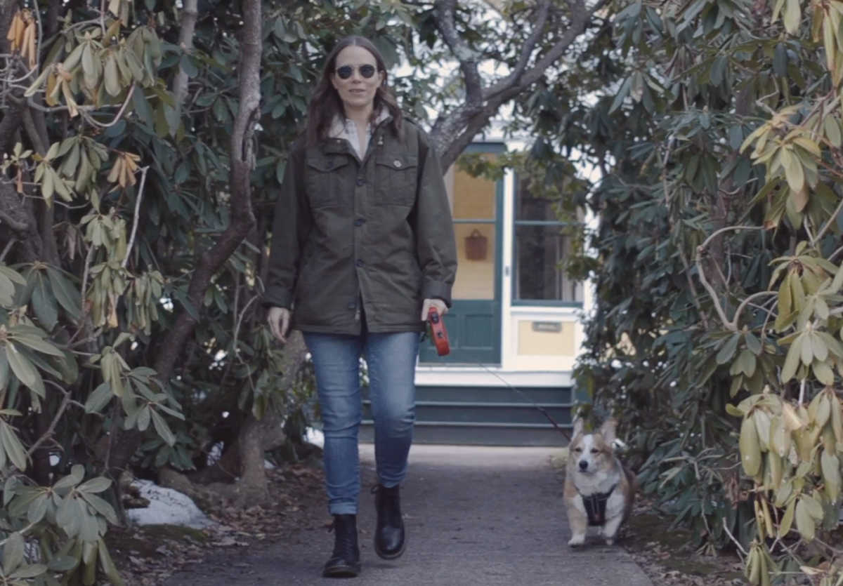 Jules walking with their dog, Lucius.