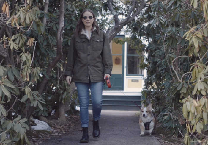 Jules walking with her dog, Lucius.