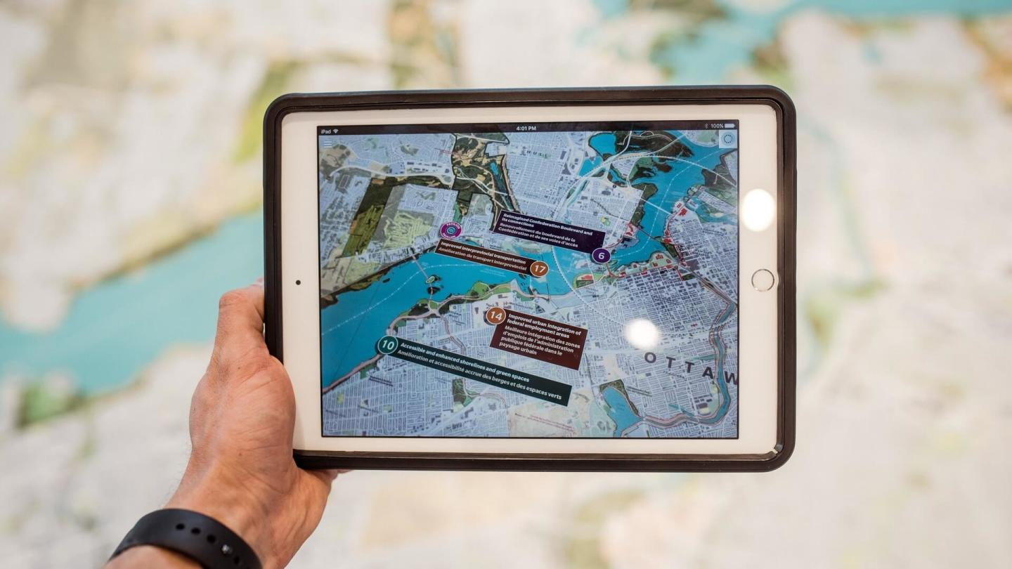 Point of view of person holding ipad with map on it.