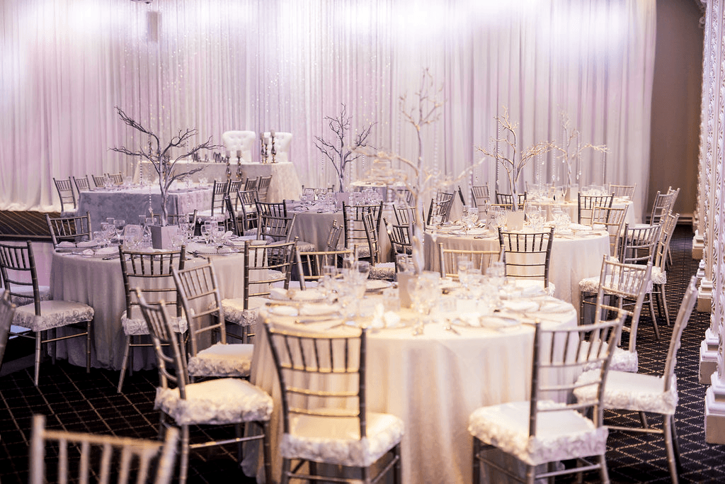 Table seating with white and gold accents at the Queen Anne venue at Paradise Banquet Halls.