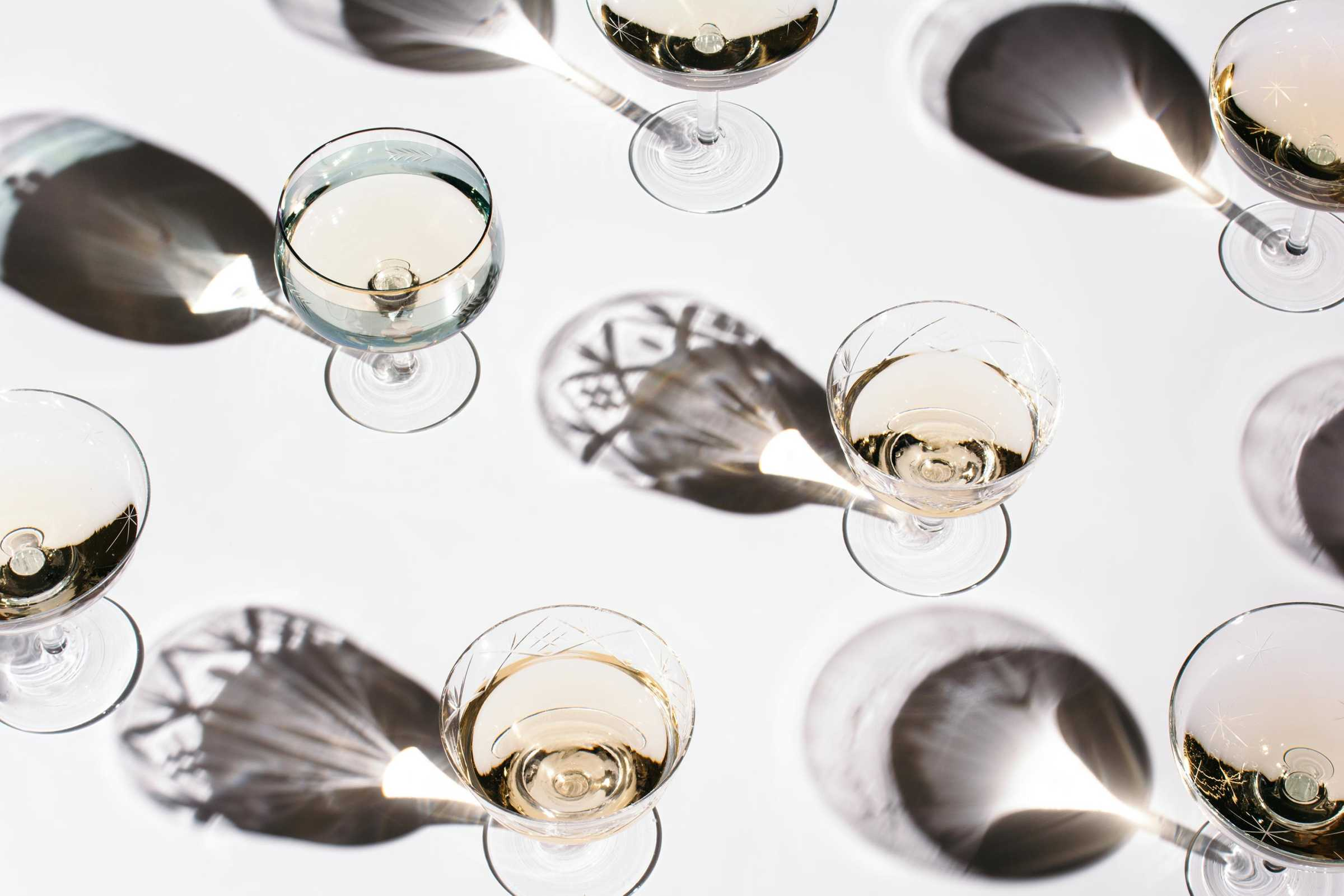 A top-down shot of glasses of chardonnay.