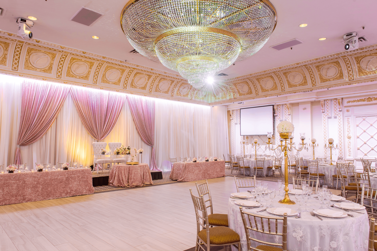 The Queen Victoria venue at Paradise Banquet Halls with a large dance floor, tables and chairs, and a head table.