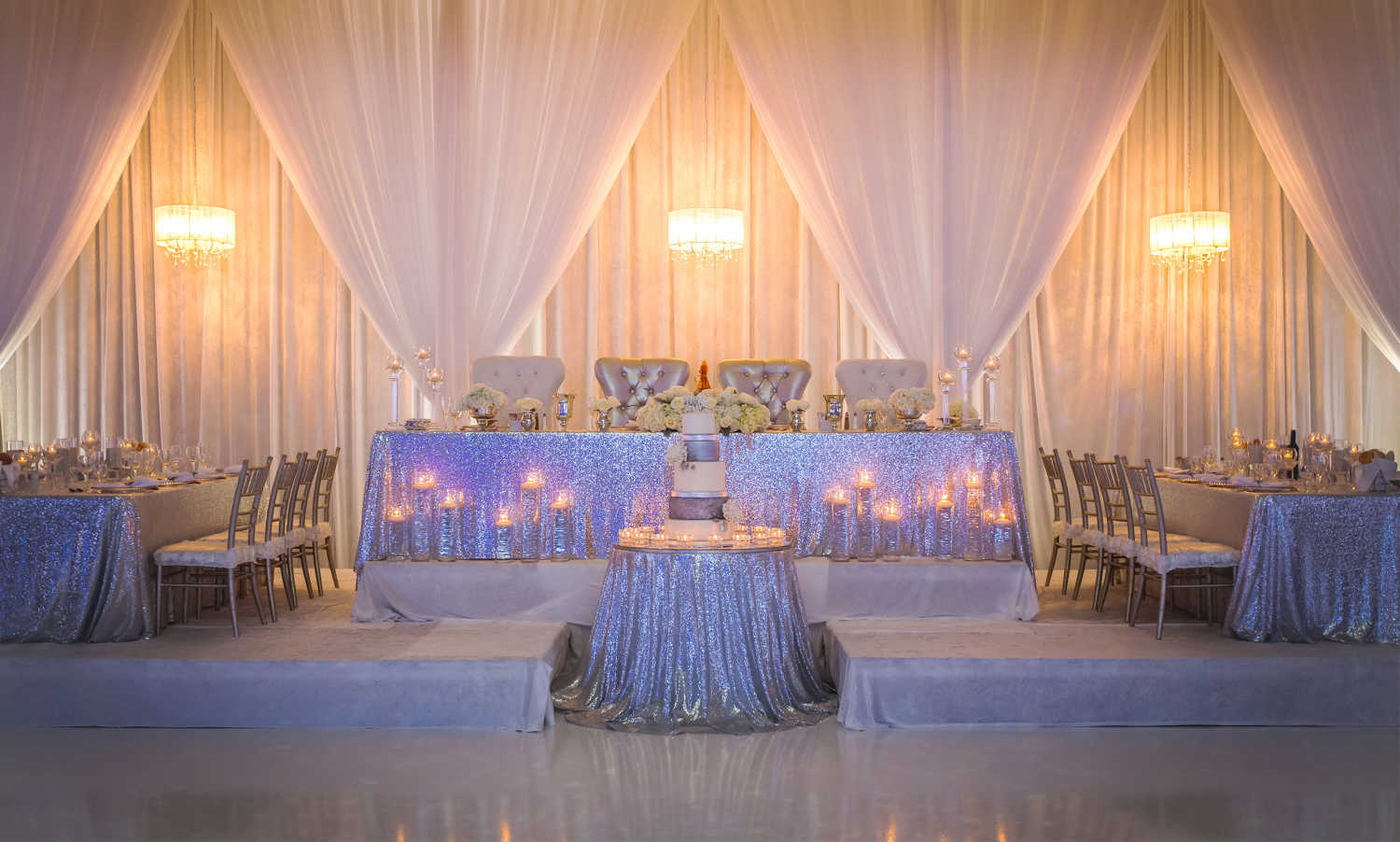 The head table for a wedding hosted at The Three Queens (Grand Queens) venue at Paradise Banquet Halls.
