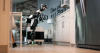 A prototype robot cleans inside a home