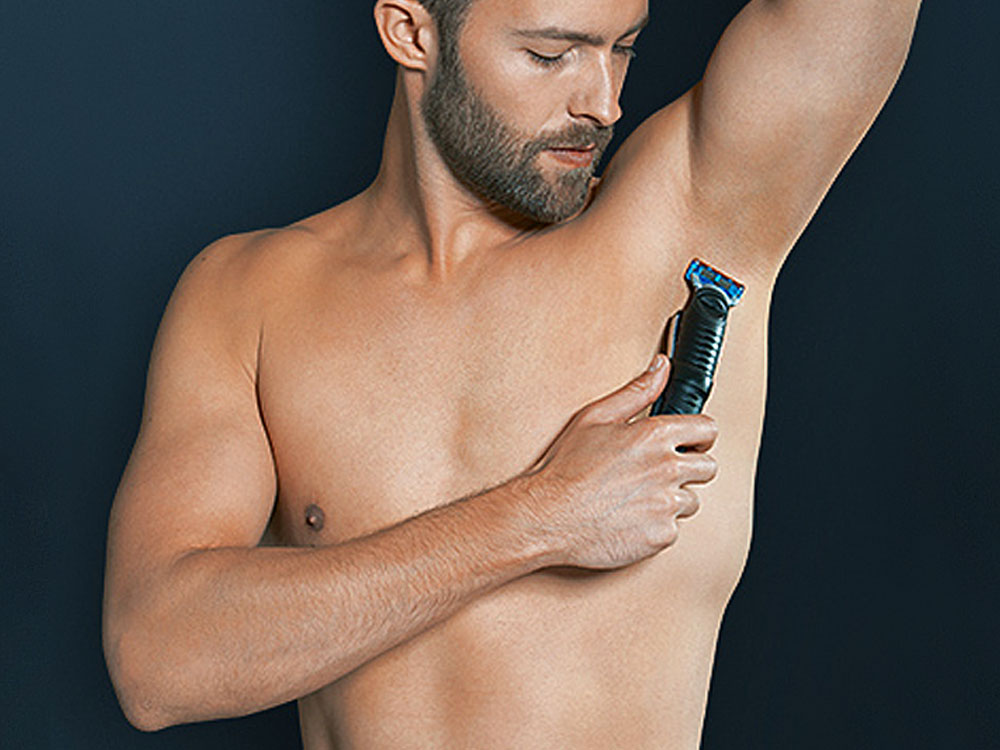 Trim the hair on your lower stomach with Braun body groomer