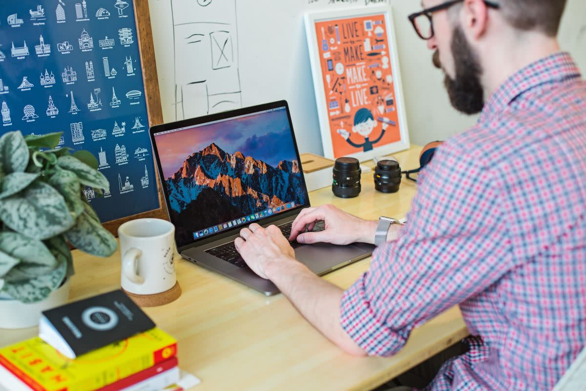 Creative marketer working on laptop at a desk