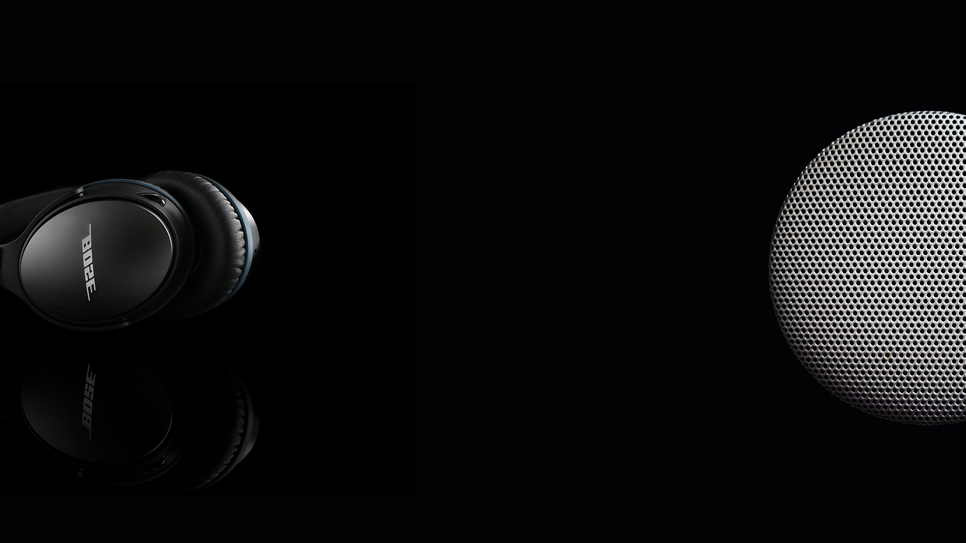 Bose headphones and speaker on black background.