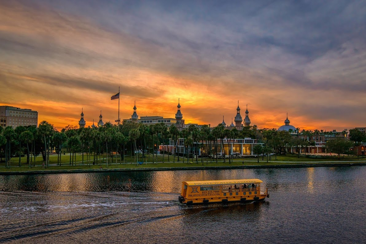 Swoop | a picture of the Pirate Water Taxi on the river in Tampa with the sunset in the background